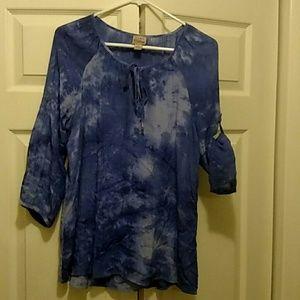 Purple/blue tie dye shirt.